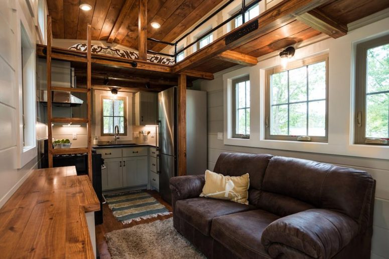 Inside this tiny house there's actually enough space for a living area, a kitchen, a bathroom and two bedrooms