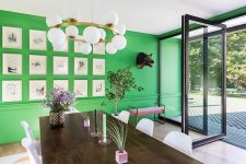a cute gallery wall on green background
