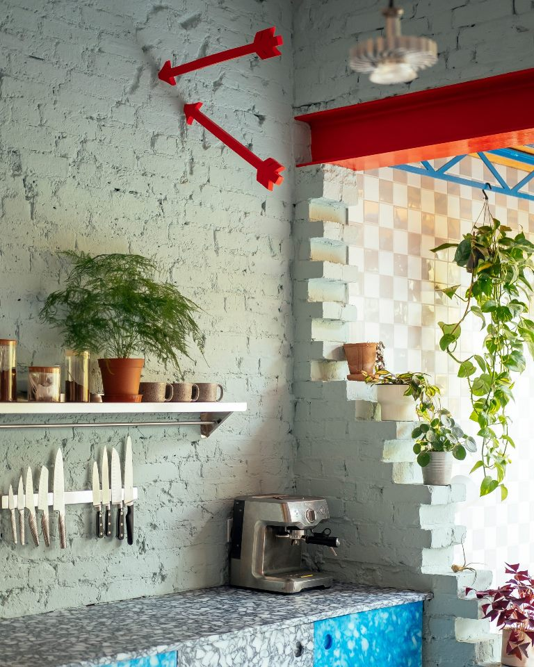 The kitchen is made from recycled chopping boards and milk bottle tops