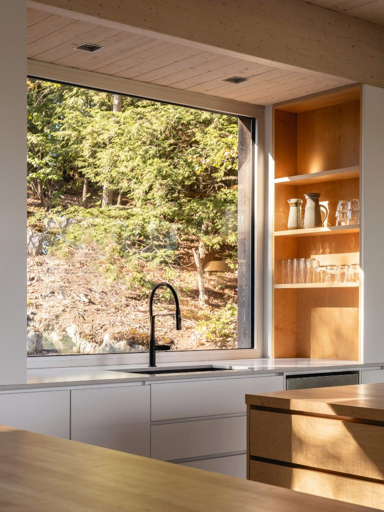 The kitchen islands are among several elements made from solid maple