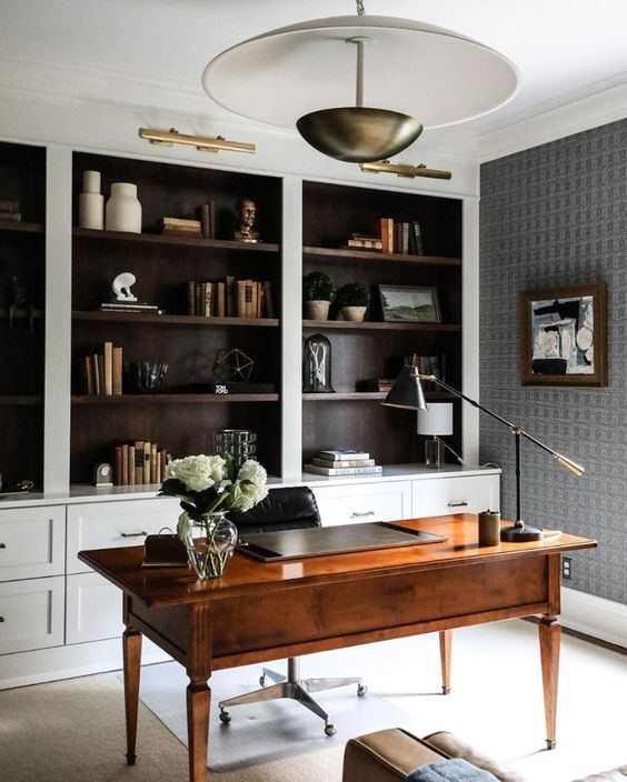 a stylish vintage wooden desk perfectly matches the style of the space and looks elegant and chic