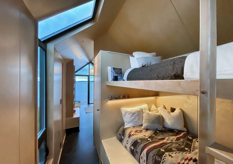 Here you may see two sleeping spaces with lights and a window with a skylight