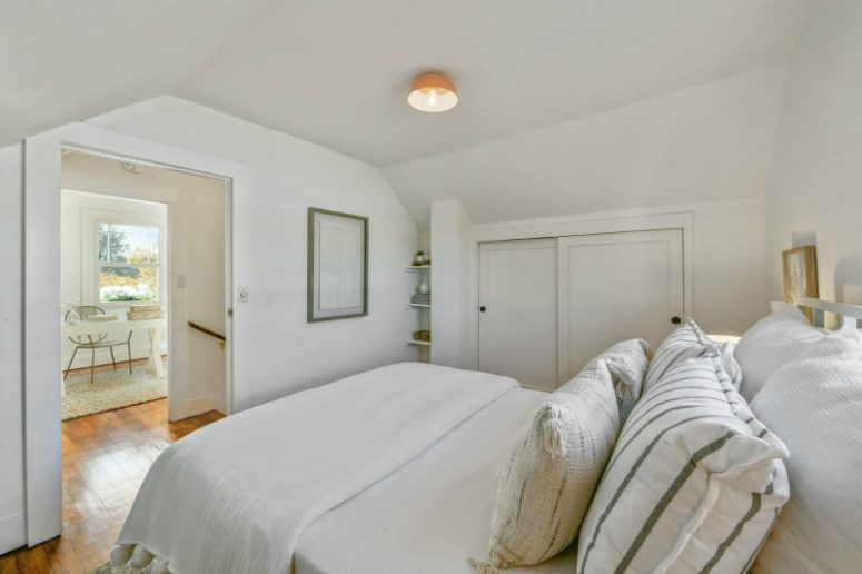 The bedroom is all about neutrals, simple furniture and hidden or floating storage units