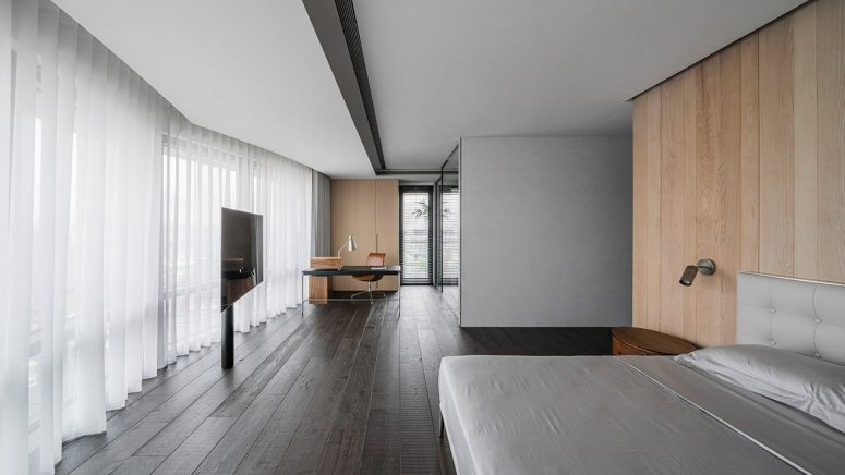 The room is very spacious and looks clean and light-filled
