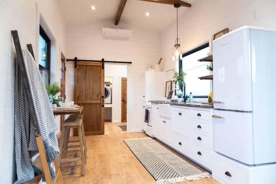The kitchen is well equipped and has generous storage as well as a farmhouse sink