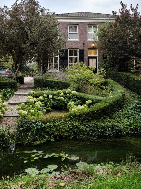 Outside there's a garden with much greenery and pure elegance, there's a cozy pond