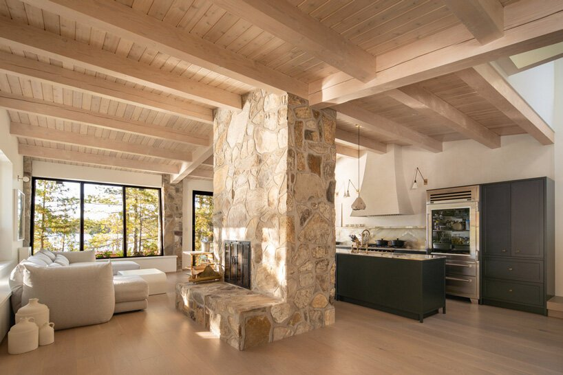 a cozy stone fireplace is a must for a log cabin