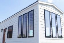 08 The tall vertical windows are paired in sets of three on this side which gives this tiny house a distinguished look