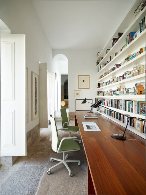 a home office with open shelves over the desk that allow organizing and don't look bulky