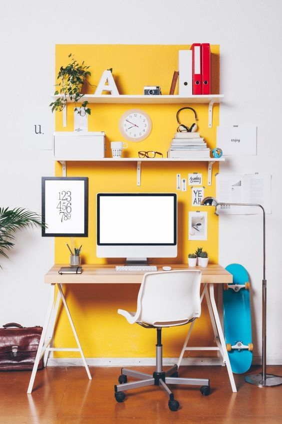 a home office nook highlighted with bright yellow paint that raises the mood and helps to wake up