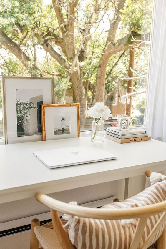 personalize your work space with some photos and blooms if you want