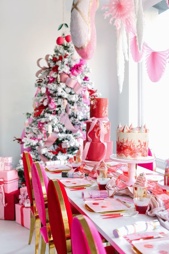 a bright Christmas space decorated in red, pink and gold, with paper fans, ribbons and ornaments is a bold idea