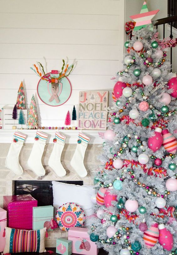 a bright and fun Christmas silver tree with pink, hot pink and green ornaments, beads and striped ornaments and stars