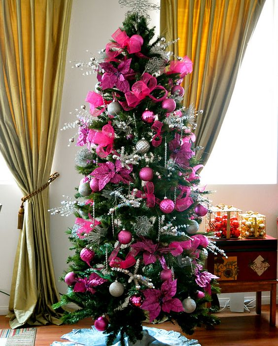 a glam Christmas tree with hot pink and fuchsia ornaments and fabric blooms, silver twigs, beads and lights is a bright idea