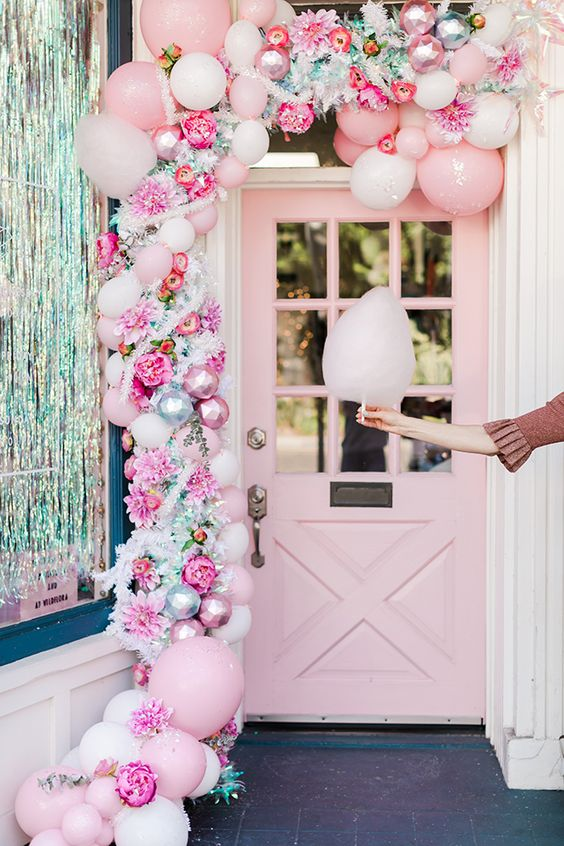 a lovely pink Christmas garland of balloons, pink ornaments, faux blooms and some greenery is a beautiful idea