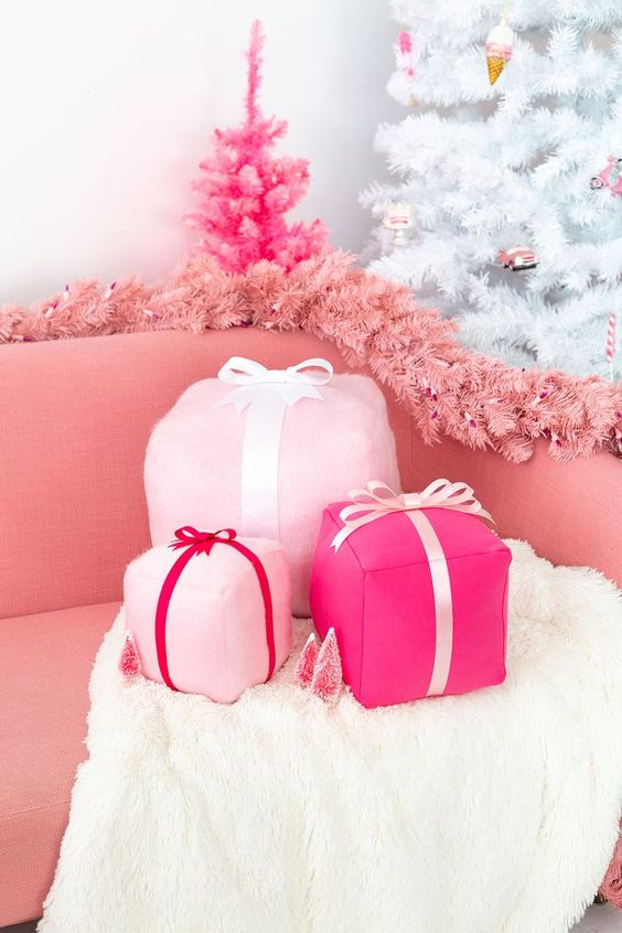 funky pink gift box holiday pillows, a pink fir garland and a hot pink mini Christmas tree decor glam and chic Christmas decor
