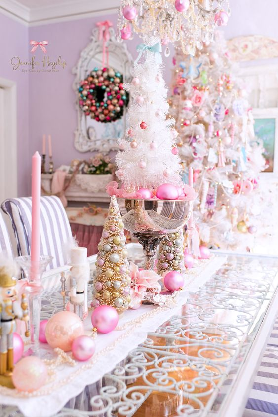 glam Christmas decor with peachy and hot pink ornaments and candles, beads, pink ornaments in a bowl and a white mini tree with blush and pink ornaments