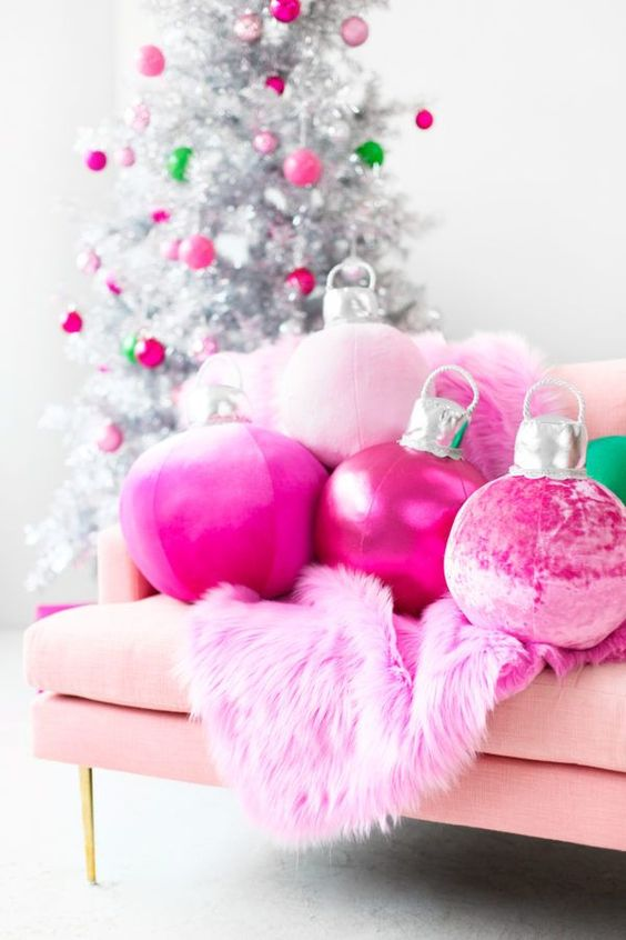 hot pink Christmas ornament pillows and a faux fur blanket plus matching ornaments on the silver Christmas tree