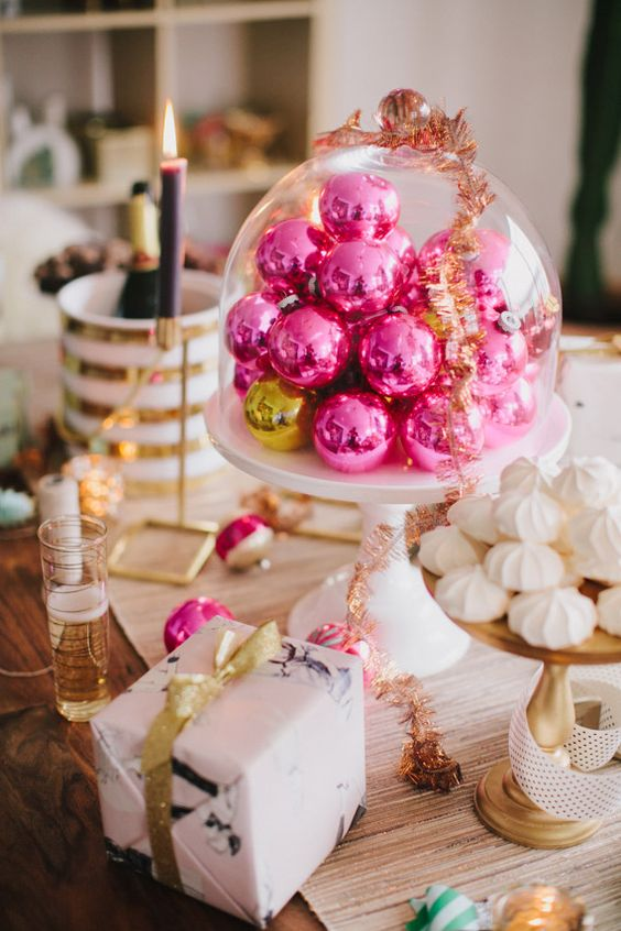hot pink Christmas ornaments in a cloche will become a lovely Christmas centerpiece or a decoration for a dessert table
