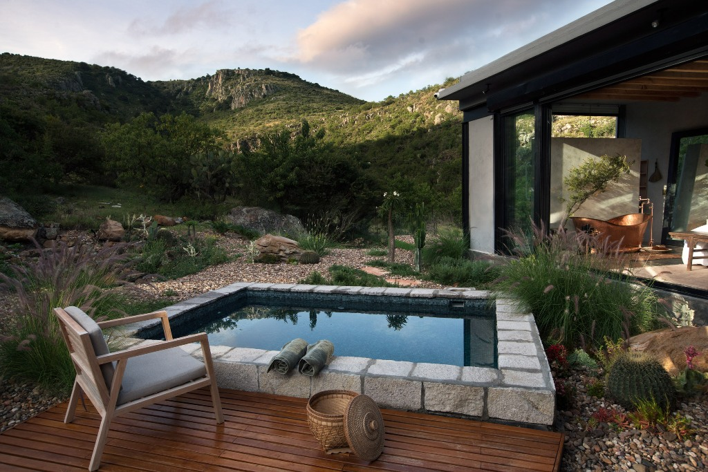 Indoors can be opened to outdoors, and there's a small swimming pool finished in mosaic tiles