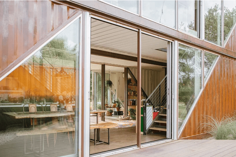 The doors are sliding and they help the indoor spaces merge with outdoor ones