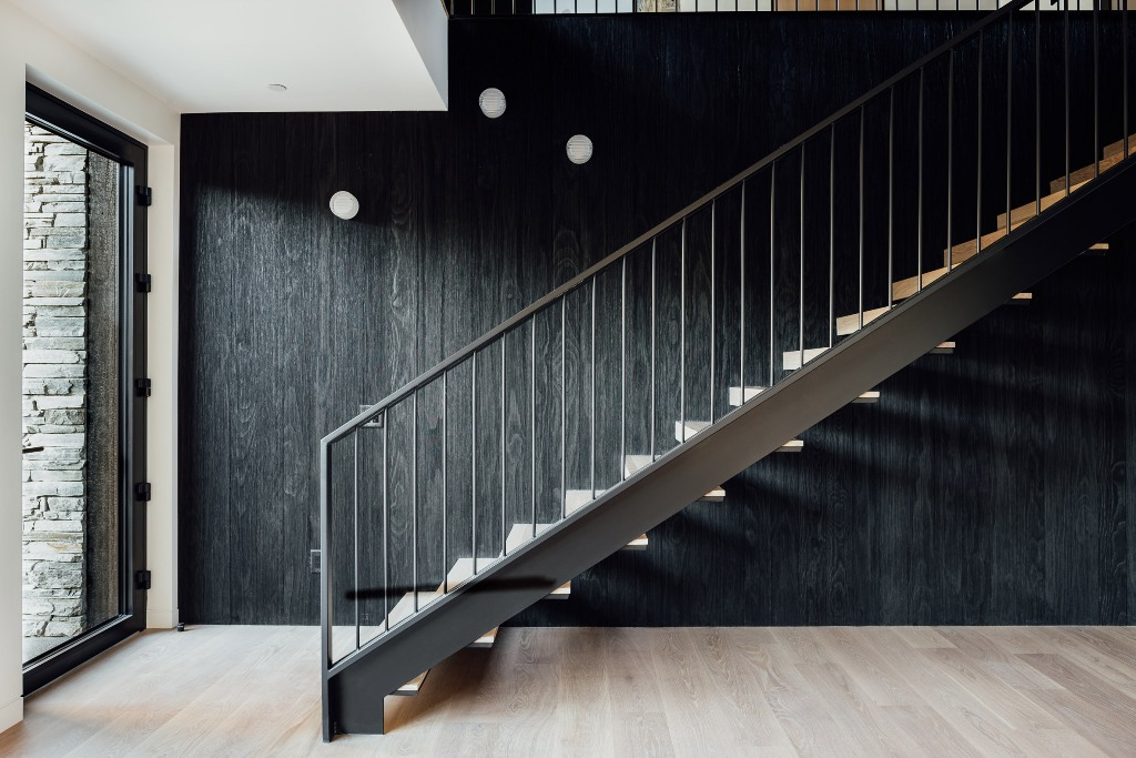 04 Dark-stained accoya lines the wall behind the staircase