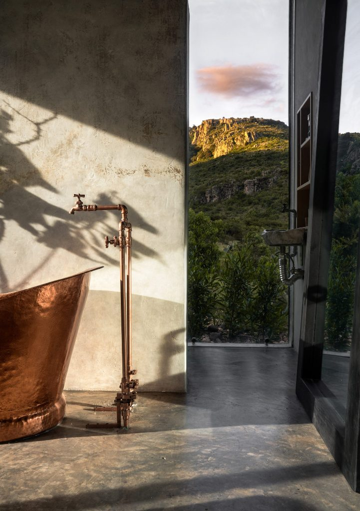 The bathroom area is fringed by floor-to-ceiling windows to get maximum of the views around