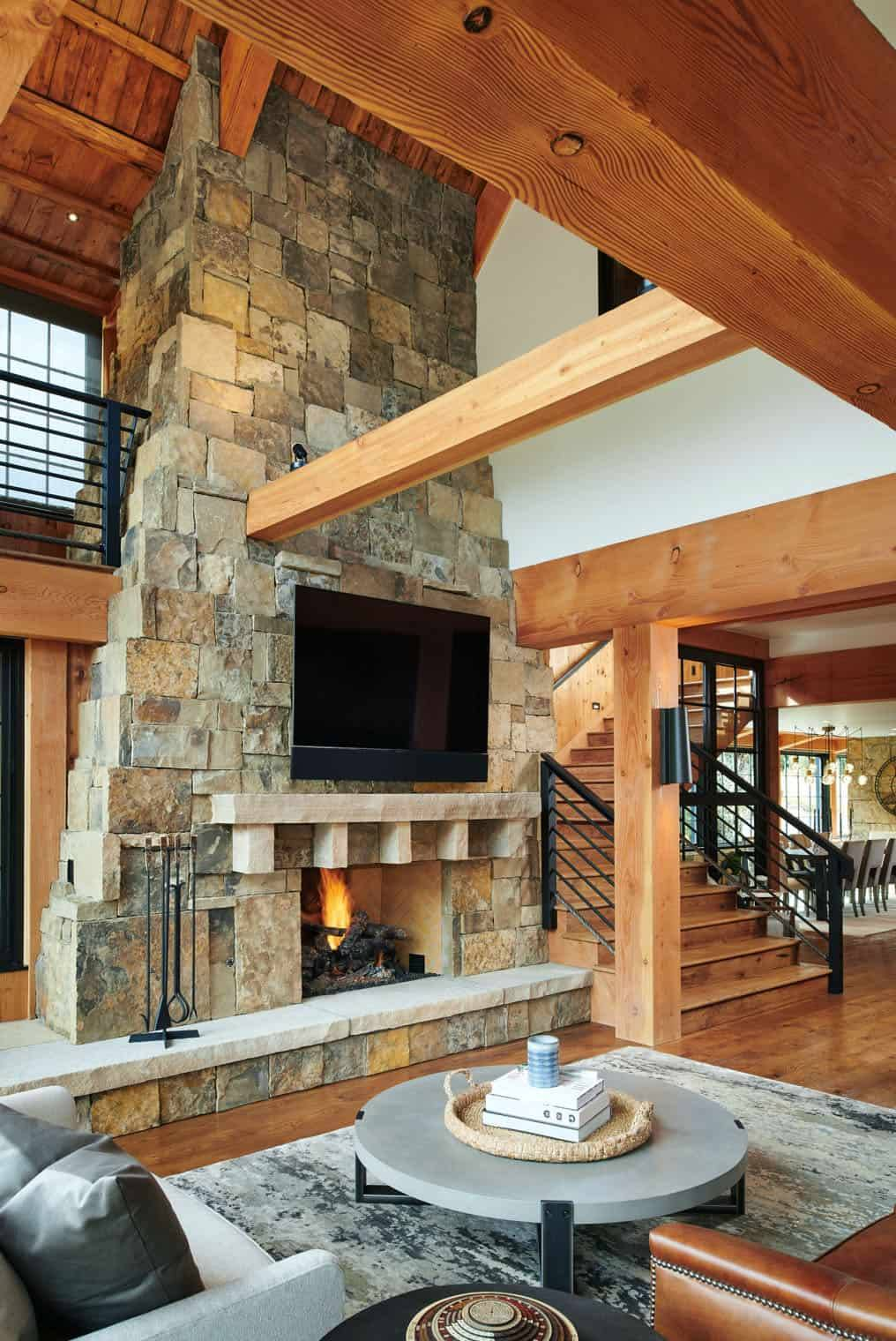The living room shows off a cool two story stone fireplace, and that is a centerpiece