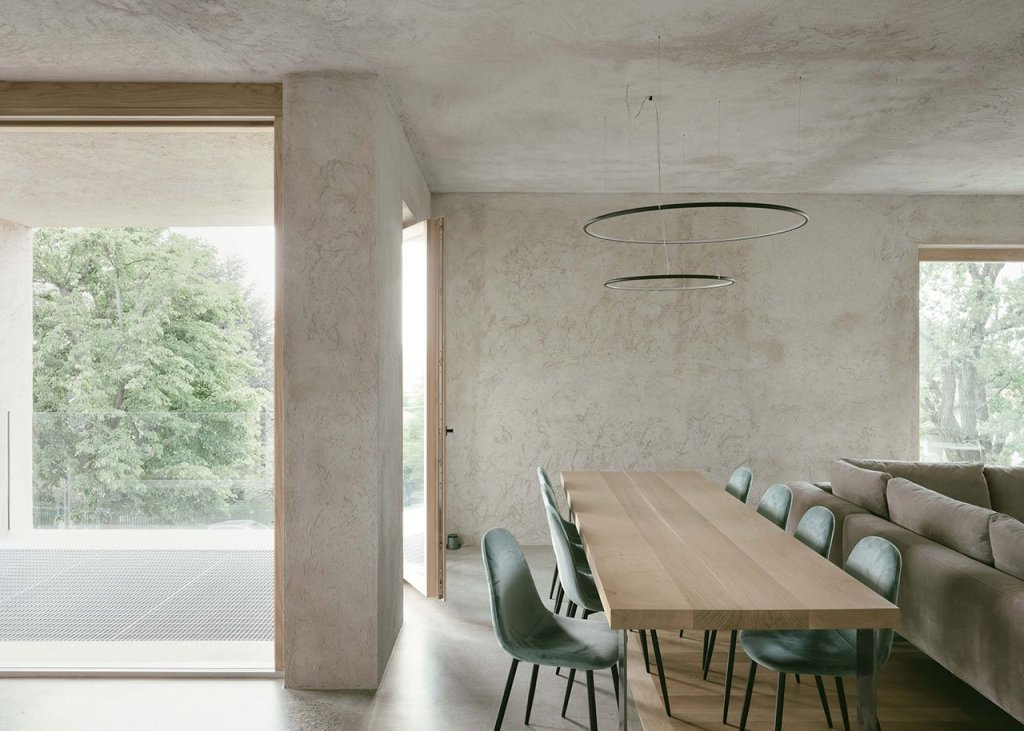 The dining room is united with the living room and the layout is done in neutral shades and with minimalist style