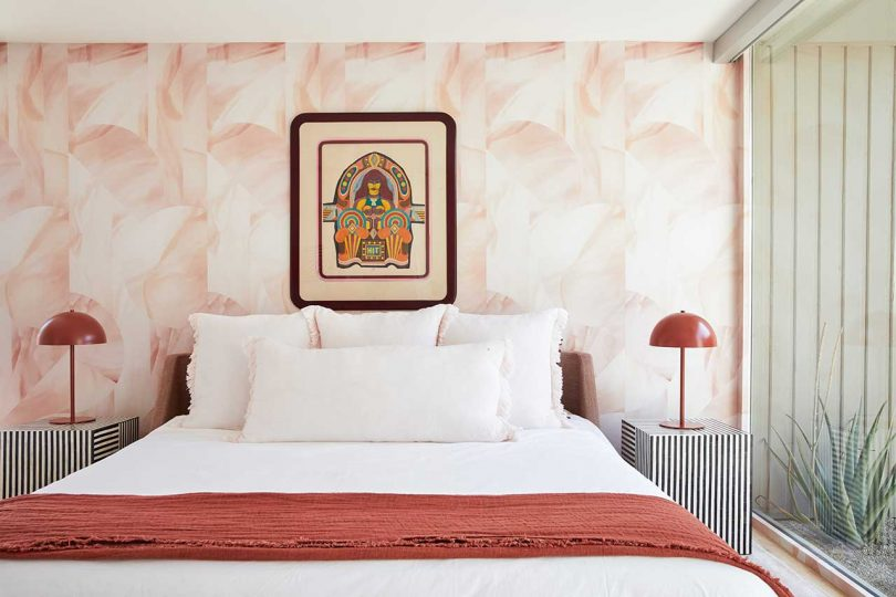 Another bedroom is done with reddish shades, with quirky furniture and art