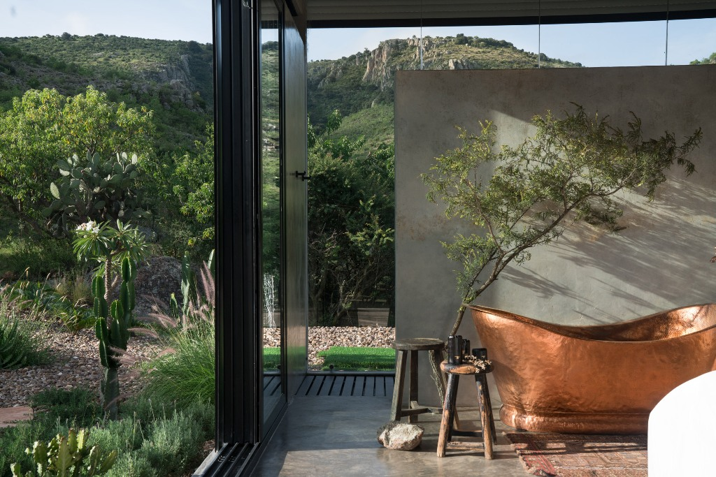 There's a copper bathtub right in the bedroom, and a privacy screen to enjoy only the courtyard looks