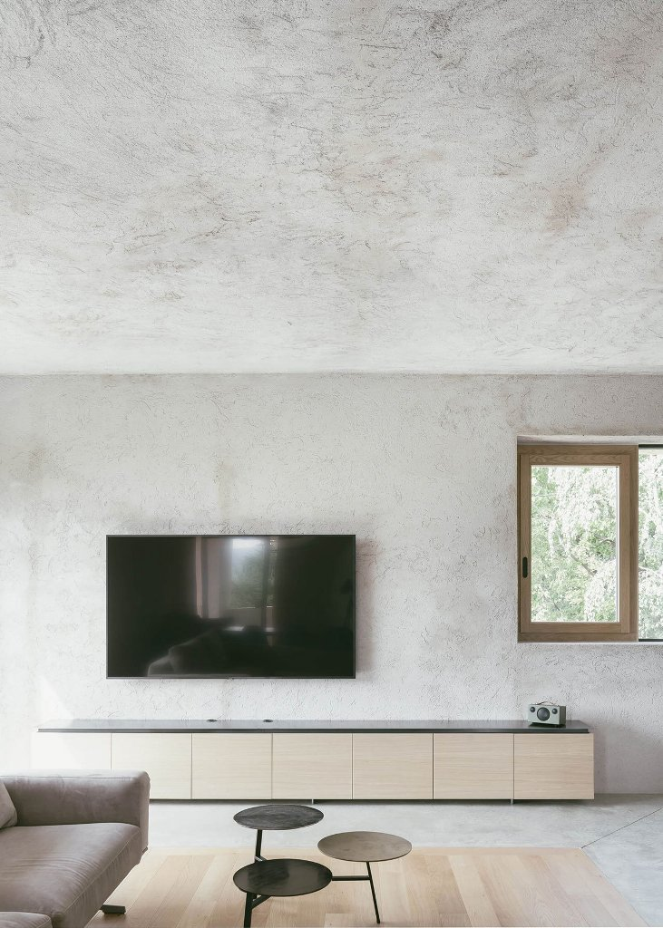 The furniture is sleek and minimal and the decor continues the exterior, which is also minimal