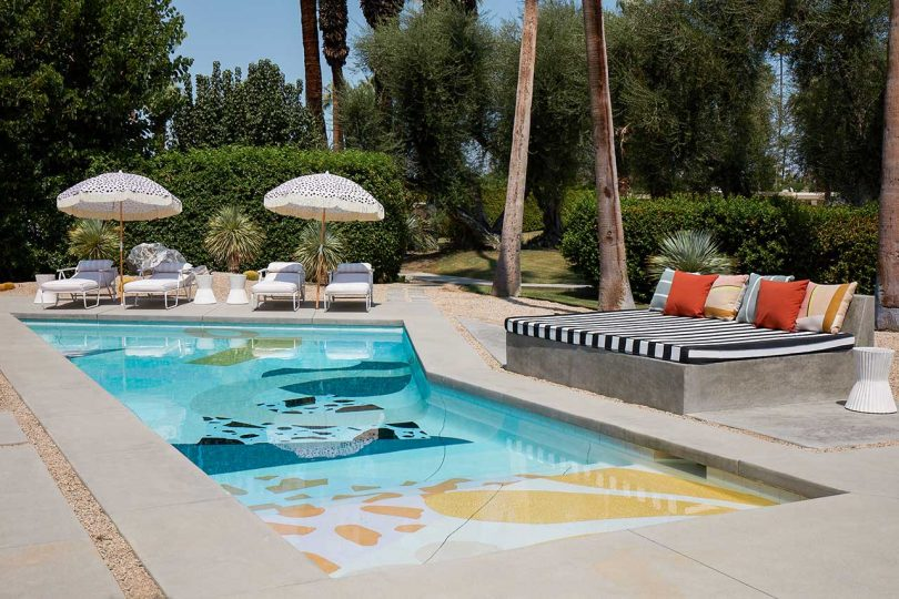 a gorgeous pool design with terrazzo floor