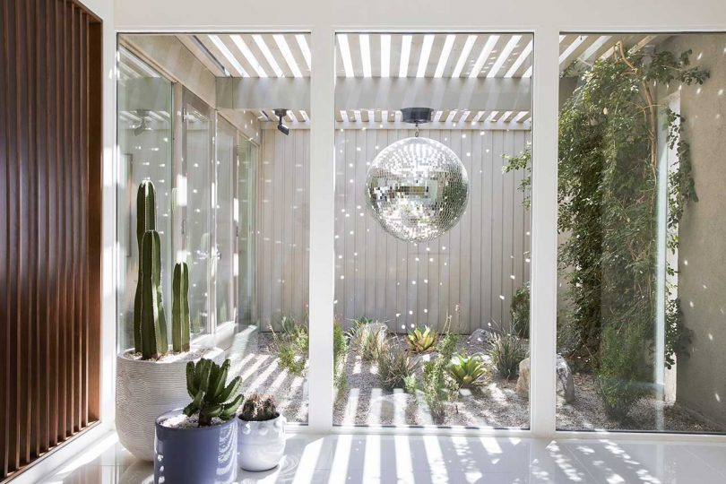 The entryway has a disco ball reflecting the light around the atrium walls