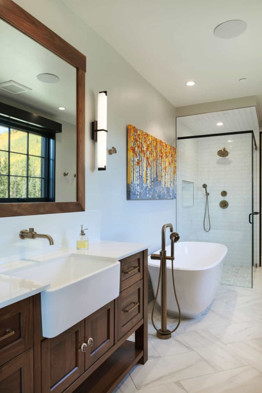 The bathrooms are modern and rustic, with wooden furniture and dark metal fixtures