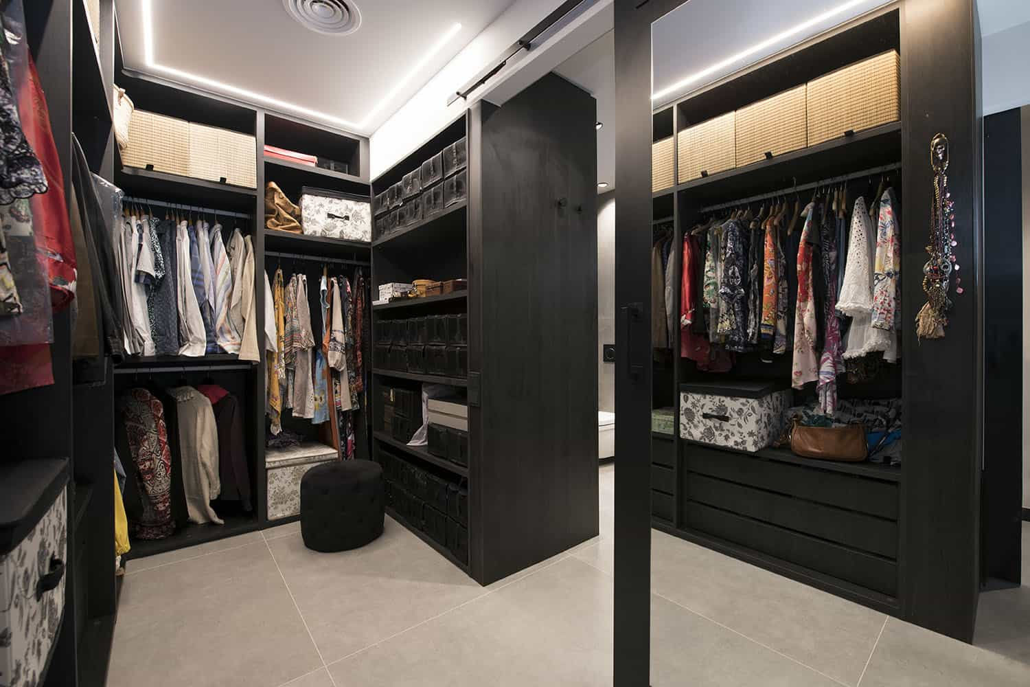 The closet is done in neutrals but the furniture is very dark, there's enough light still