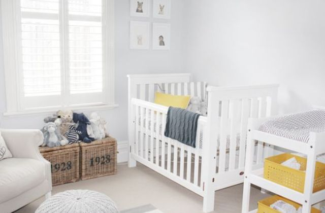 an ethreal dove grey nursery with elegant white furniture, grey textiles, a mustard toy car and some more yellow details