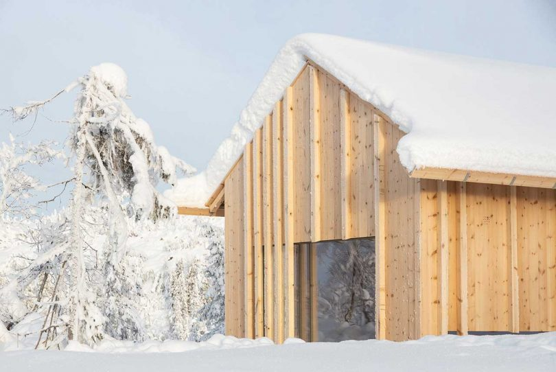 The exterior and interior are clad with pine wood to merge with nature and to feel coziness