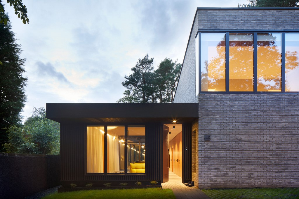 The brick facades are teamed with portions of vertically slatted timber