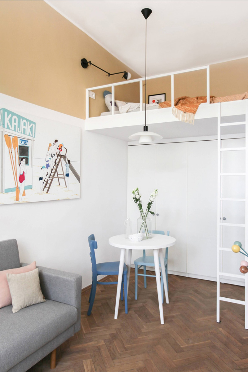 There's a small dining space, tall wardrobes and a loft bedroom with a ladder plus cool lamps