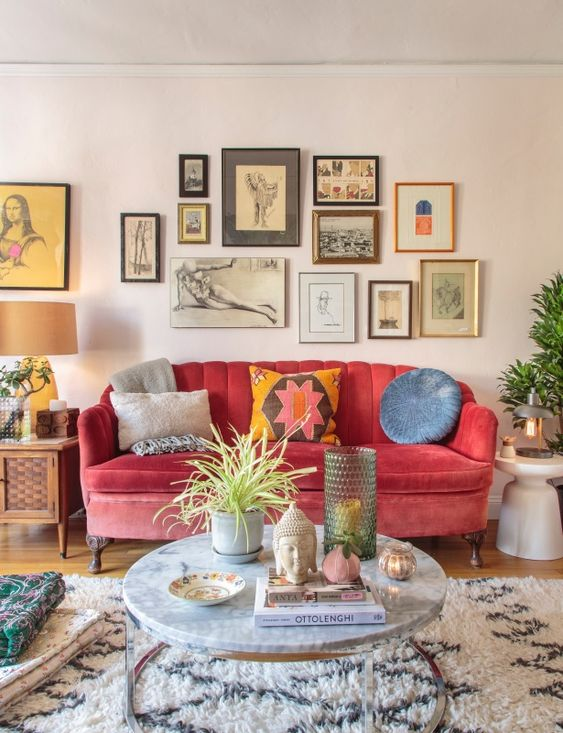 04 a colorful global bohemian living room with a pink sofa, colorful pillows and a gallery wall with bright artworks