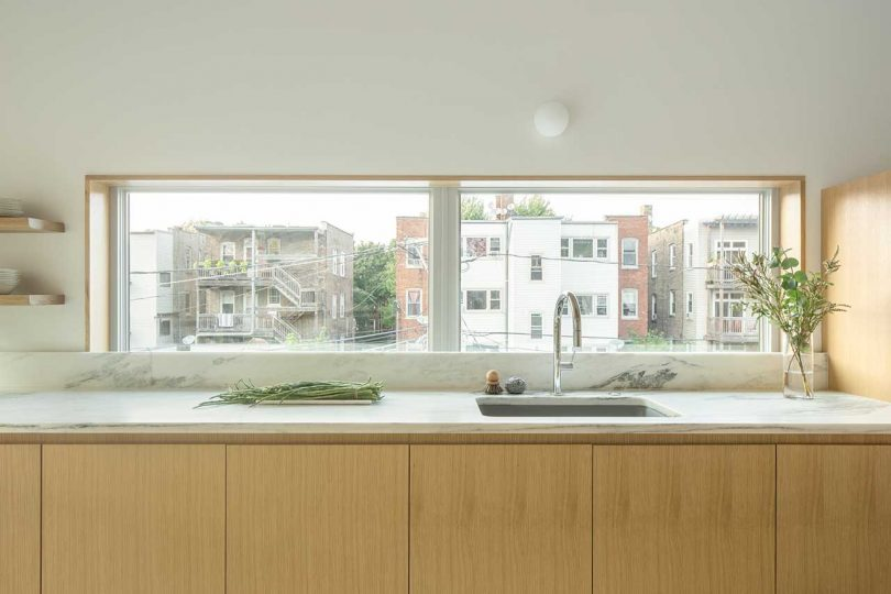 A backsplash is substituted with a window to fill the kitchen with natural light as much as possible