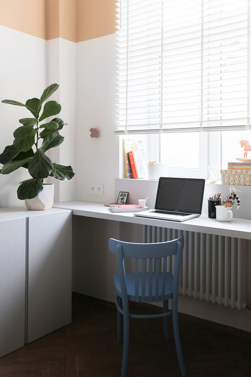 Sleek white cabinets are great for storage, and a little working space is perfectly accessorized to look nice
