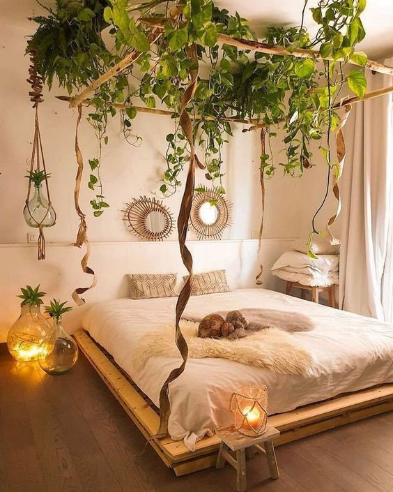 a jaw-dropping bedroom with greenery suspended to the ceiling feels relaxing and a very comfortable