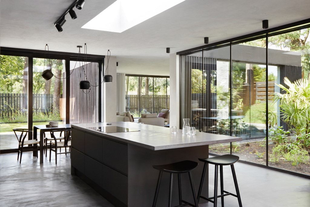 The living spaces are filled with light through glazed walls and there are open layouts