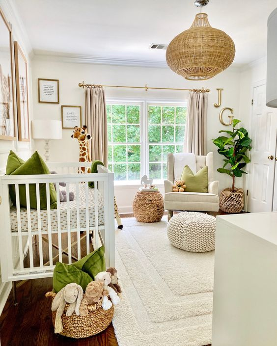 a welcoming neutral nursery with bold green textiles, a rattan lamp and woven ottomans plus a cool rug