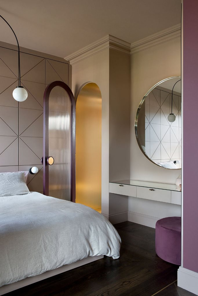 The bedroom is done with lilac and purple touches, with gold for elegance
