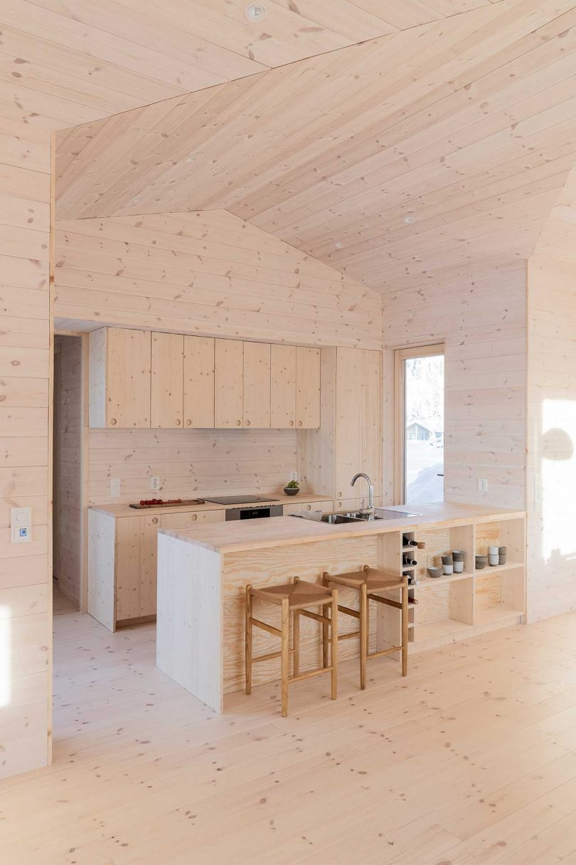 The kitchen is fully made of pine, it's airy and very welcoming and windows bring light inside