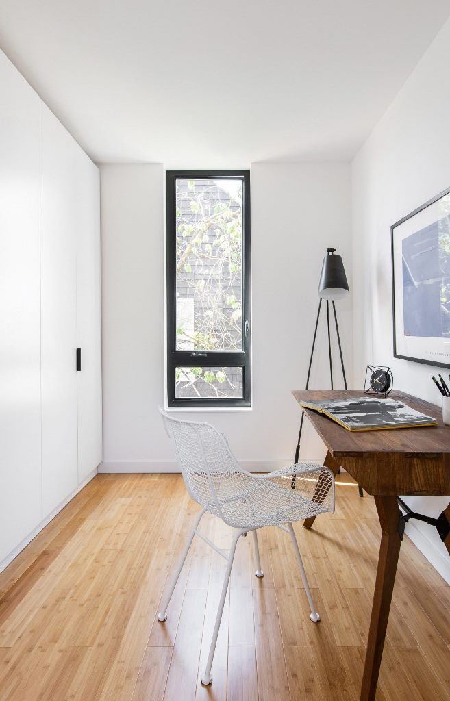 The workspace is done with sleek wardrobes, a vintage desk and a metal chair