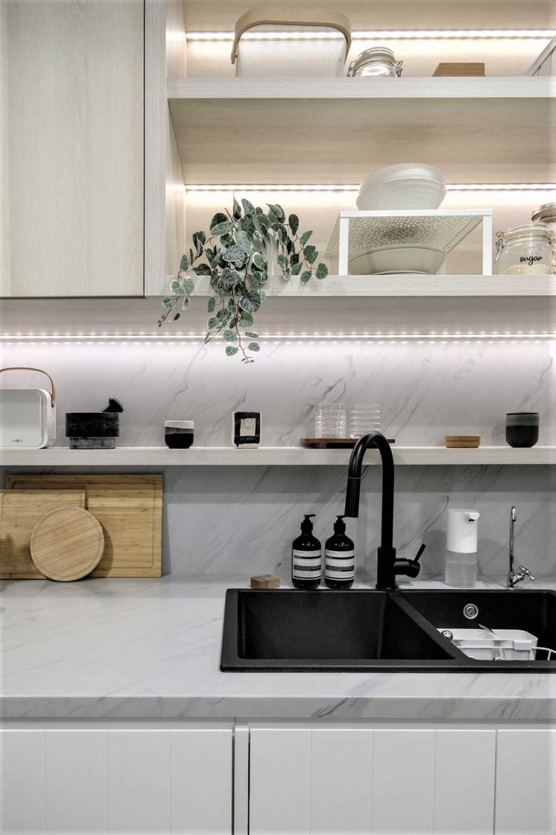 Smart built-in lights visually expand the space and the use of neutral colors only is for the same